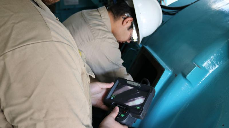 Students from Northeastern Junior College learn using borescope donated by NextEra Energy.