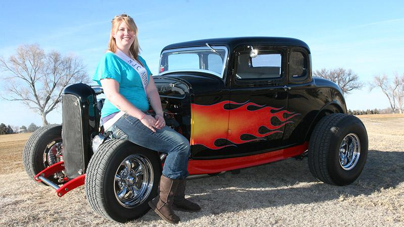 "Lauren Hegstrom of Arvada is ready to do her duties as the 2011 Auto Show Queen. She's shown here with a 1932 Ford five window coupe owned by Roger and Cherie Brungardt. The car was chosen as the ""best engineered"" entry for the NJC show several years ago."
