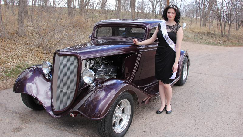 "Darrien ""D"" Allison from Flagler has been chosen as the 2014 NJC Auto Show queen. She is pictured here with a 1934 Ford 3 Window Coupe owned by Steve and Cindy Vierow of Sterling. The car is one of many that will be on display during the show this weekend at the college's North Campus."