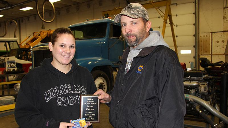 Laura Fincher of Sterling (left), the NAPA Student of the Month for October 2013, receives her award from Aaron Hettinger, the outside sales manager for NAPA.