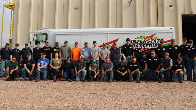 Northeastern Junior College Diesel Technology students post for a photo with representatives from Interstate Batteries of the Rockies.