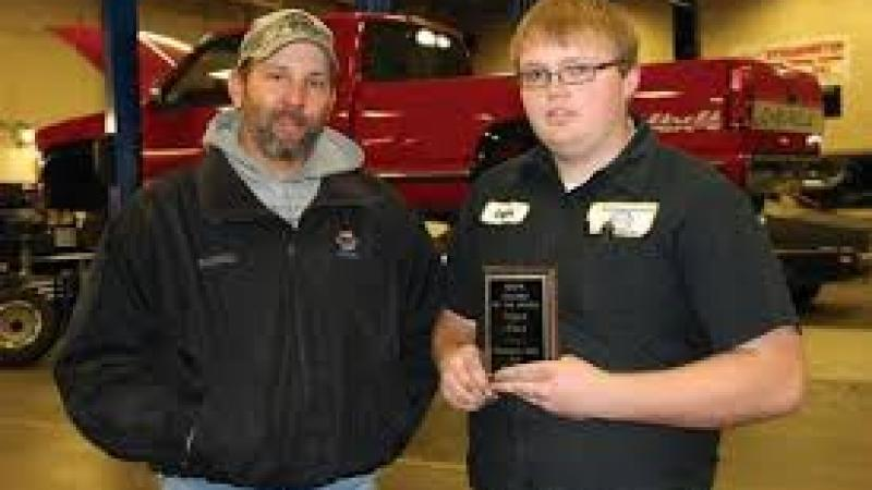 Logan Ward (right) of Atwood, a second year student in the automotive technology program at Northeastern Junior College, has been named the NAPA Student of the Month for November. Presenting the award Aaron Hettinger, outside salesman for the NAPA store.