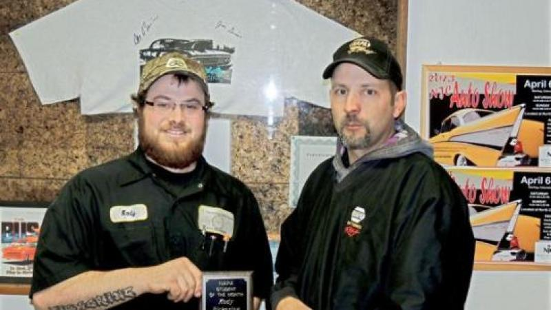 Pickering (left) is shown here receiving his award from Aaron Hettinger, outside sales manager for NAPA.