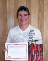 Taylor Kokes displays his prizes for having the top written score during the recent Skills USA Automotive Competition held on NJCâ s campus.