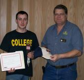 William Richendifer (left) receives the third place award for the USA Skills District Three competition frmo Layton Peterman (right) of NJC's automotive technology program.