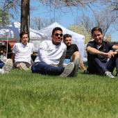 Students sitting on Courthouse lawn in downtown Sterling, Colorado during a music event