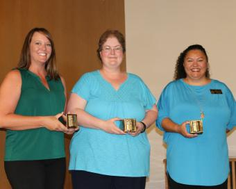 Fifteen-year award recipients, left to right, Amanda Kerker, Cathy Fisher, Celeste Delgado-Pelton