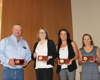 Twenty-year award recipients, left to right, Brian Cullen, Marci Henry, Annie Shalla, Andrea Wasson