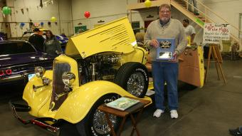 Jim Dorlan, now of Eaton, formerly of Sterling, won the People's Choice Award for his bright yellow 1934 Dodge Convertible.