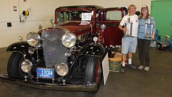 Deb and Ray Hardy of Yuma pose with their 1932 Cadillac LaSalle that captured the big prizes this year at the NJC Auto Show when it was selected as the 2015 People's Choice entry as well as also being named Best Display winner. These prizes are determined by votes from the public and the various exhibitors participating in the show.