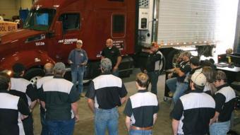 Warren Baker and Michael Job talking to Diesel Tech students