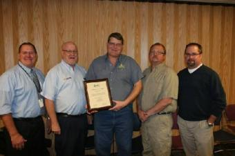 Layton Peterman, head of the automotive technology program at NJC (center, holding plaque) is flanked by some members of the college s automotive program advisory committee who helped oversee the ASE accreditation process including, (from left) Wally Beardsley from RE1 Valley School district, Tim Richie from NAPA Auto and Truck Parts, Peterman, Arlin Dressel of ALD Automotive (Yuma) and Mike Schadegg of Wolf Auto.